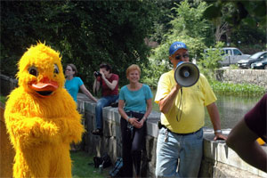 Barbara Miller judging the duck race